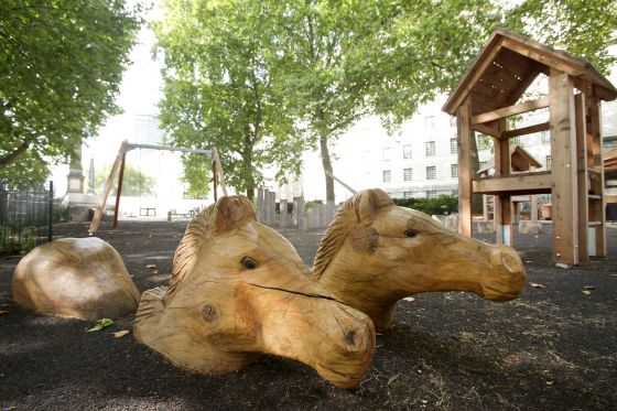Wooden horses at Horseferry Playground
