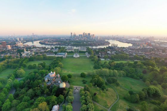 A view across Greenwich Park towards the Thames at sunrise