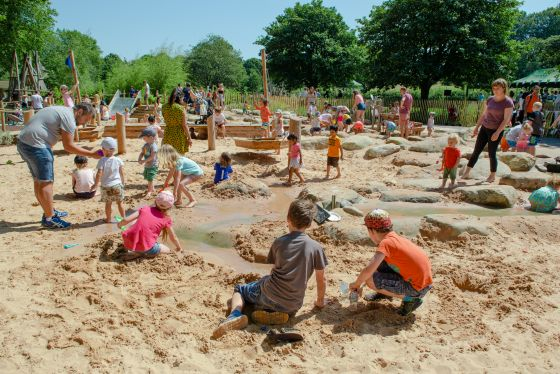 Children playing in the sandpit at the newly refurbished playground