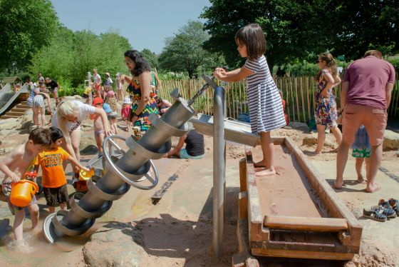 Children playing happily with the Archimedes screw