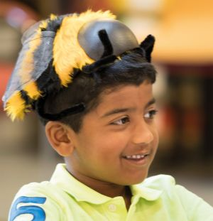 Boy with bee hat