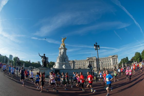 Runners in the Royal Parks Half Marathon passing Buckingham Palace