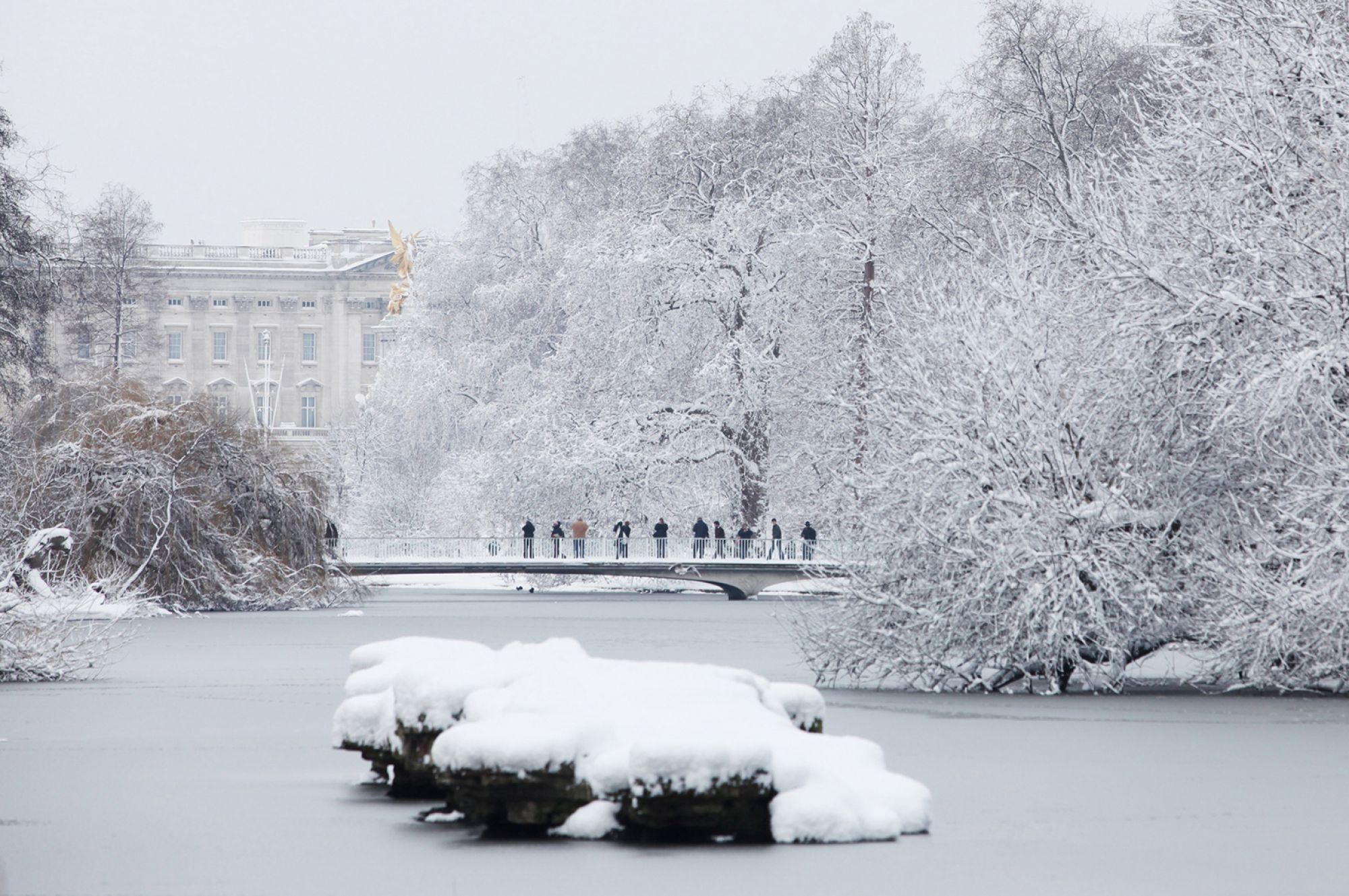 St James's Park lake in the winter snow