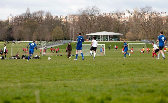 A football game on the pitches outside The Hub