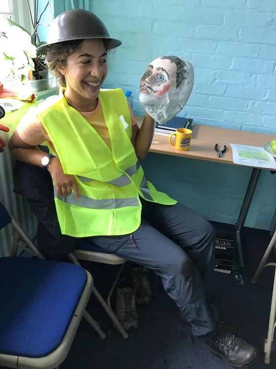 Our replica papier mache head, Danny, with a volunteer.