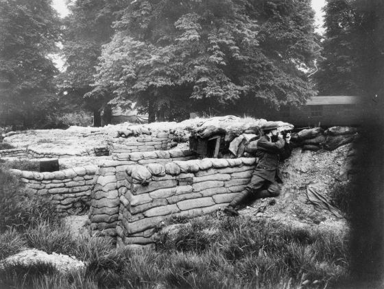 Soldier in a trench in Kensington Gardens