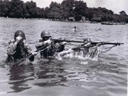 An unusual sight: American soldiers demonstrating in the Serpentine, 1943. A party of American soldiers, wearing battle kit, swim across the Serpentine during a military demonstration. Credit:  ACME Photo