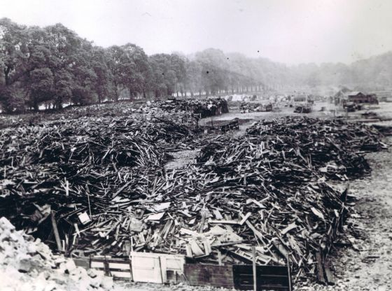 Hyde Park as a salvage depot, 1941. Wood and other property salvaged from bomb-blitzed sections of London are neatly piled up in the bomb salvage dump.  Credit: ACME Photo