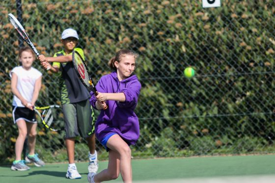 Youngsters playing tennis